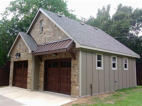 metal garage with apartment metal awning above garage doors shop ideas