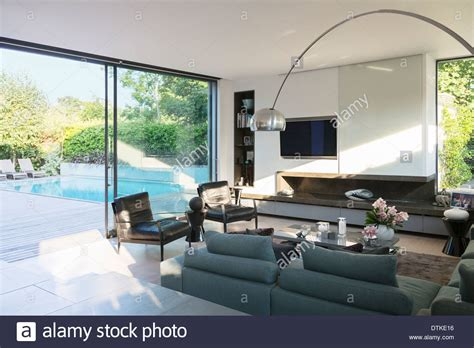 Living Room In Pool by Modern Living Room Overlooking Patio With Swimming Pool