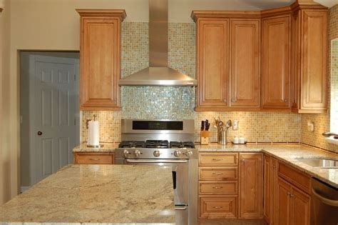 maple cabinets with light granite countertops kitchen