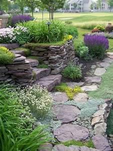 steingarten mit steinmauer gestapelte steine bunte With katzennetz balkon mit hape garden stacker