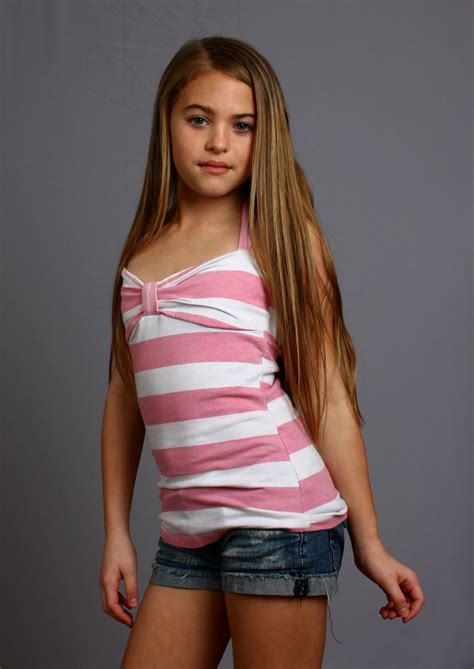 Get Free Stock Photos Of A Beautiful Young Girl Posing On A Gray Background Online Download