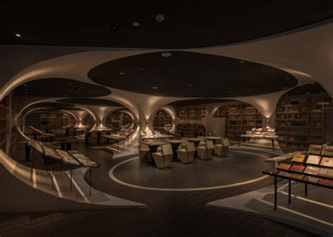 Cavernous Cool Interior by Tunnel Of Books Shelves Wrap Curved Bookstore Walls
