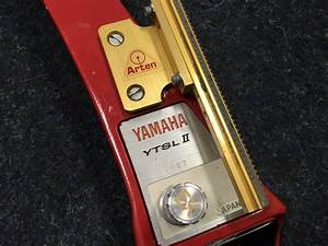 A Cased Archery Set  The Yamaha Ytsl Ii Bow With Two