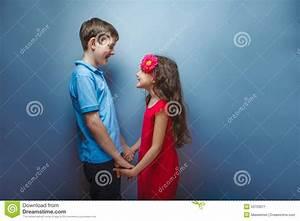 Teen Girl Holding Hands Teenage Boy On Gray Stock Photo ...