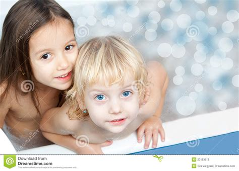 Kids Shower Head Toy by Sisters Have Fun In The Bath Royalty Free Stock Image