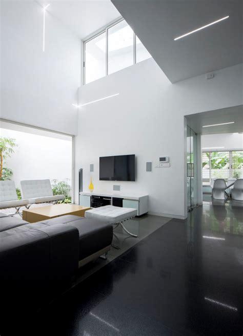a modern home exterior contains a clean modern interior
