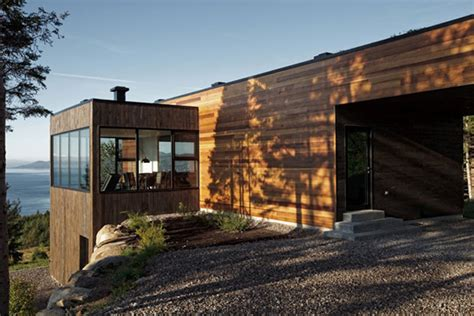 quebec cottage home clad   surrounded  woods