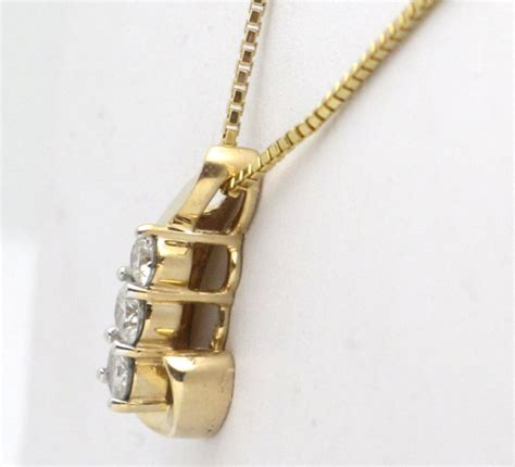 yellow gold diamond  stone  present future