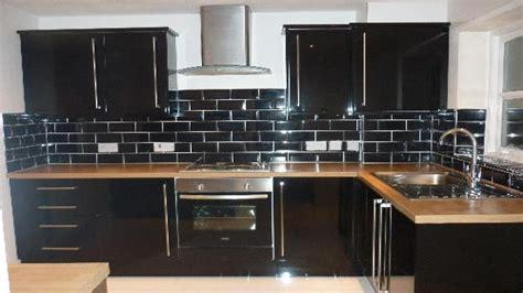 black glass tiles for kitchen backsplashes black glass subway tile backsplash