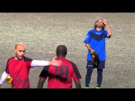 female soccer player disguised  man stuns male soccer
