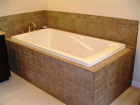 Tiling A Bathtub Deck by Hardwood Master Bedroom With Custom Porcelain Bathroom