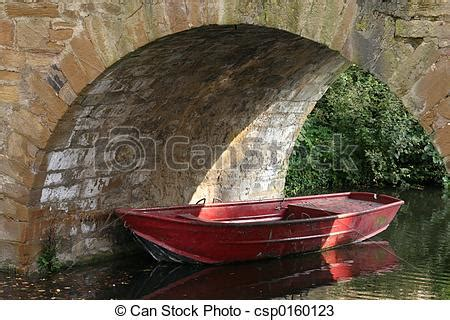red boat rowing boat   bridge stock  search