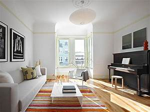 A modern pendant light in bright living room decoist