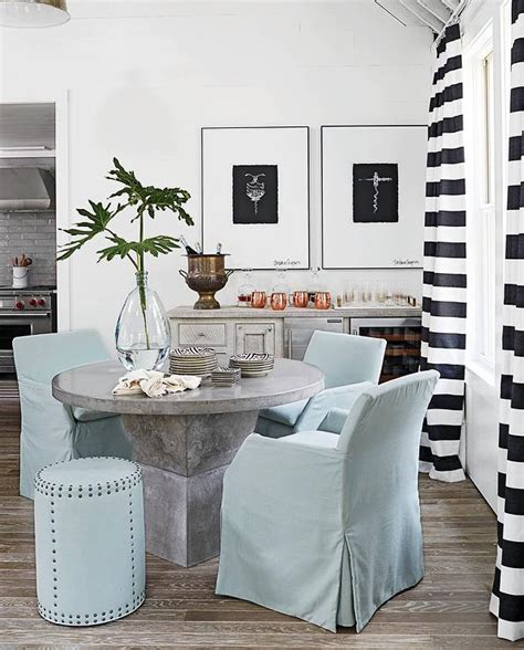 cottage dining room with black and white striped curtains