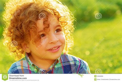Cute Baby Boy On Green Field Royalty Free Stock Image