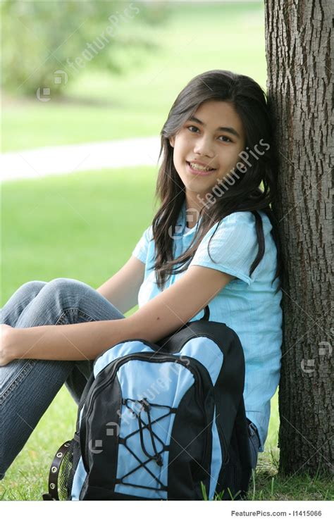 Teen Girl Leaning Against Tree With Backpack Stock Photo I At Featurepics