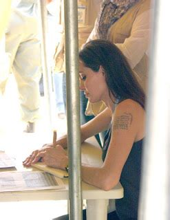 trouve tout le nouveau tatouage dangelina jolie fait