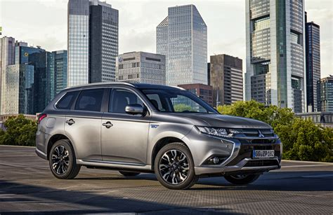 Mitsubishi Outlander Sport 4k Wallpapers by Silver Car Mitsubishi Outlander In The Background Of