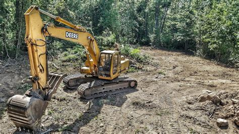 john deere lc excavator clearing trees drone view youtube