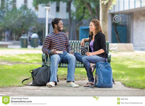 Students Sitting On Bench At University Campus Stock Photo Marble Top Round Coffee Table Folding Tables Hayneedle Malaysia Furniture Modern Nesting Italian Leather Ebay