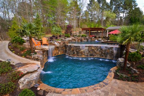 multi level pool  stonework  palm trees hgtv