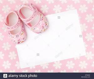 Blank card with baby girl shoes on a pastel pink floral ...