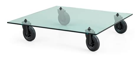 A Gae Aulenti glass and rubber wheel sofa table, 'Tavolo con Ruote', Fontana Arte, Italy