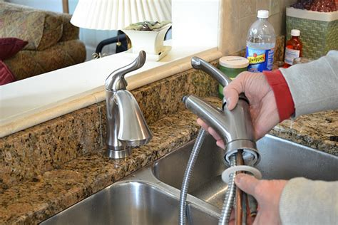 change kitchen faucet how to replace a kitchen sink faucet