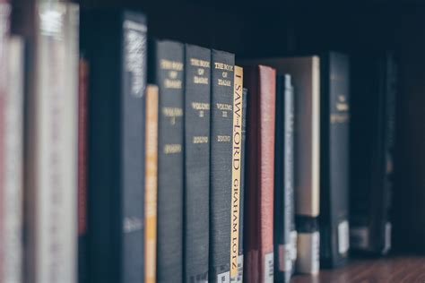 books  black wooden book shelf  stock photo