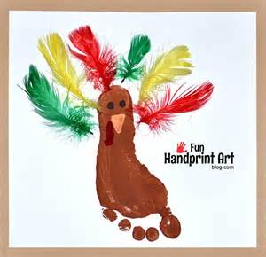 make a footprint turkey using feathers handprint