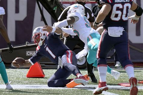 Newton runs for 2 TDs, Patriots hold off Dolphins 21-11 | WBFF