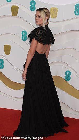 BAFTAs 2020: Margot Robbie wears ruffled black lace gown ...