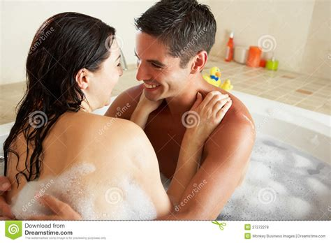 Couple Relaxing In Bubble Filled Bath Stock Photo-image