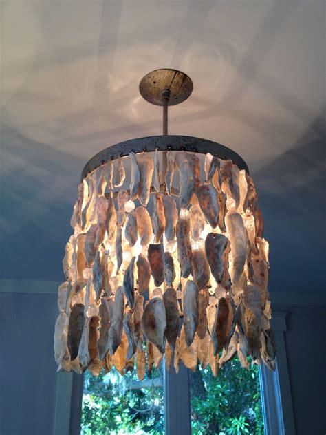 shell light fixture dining room beach  beach house