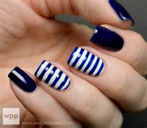 Striped navy blue nail art