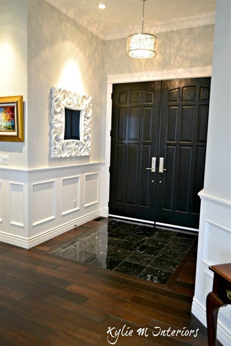 Entryway with dark wood flooring, black marble tile and