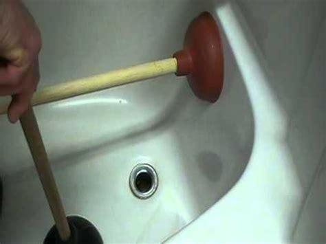 unclog bathtub drain with water how to unplug or clear a bathtub drain easily