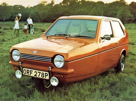 reliant robin color coded advertising orange ran when parked