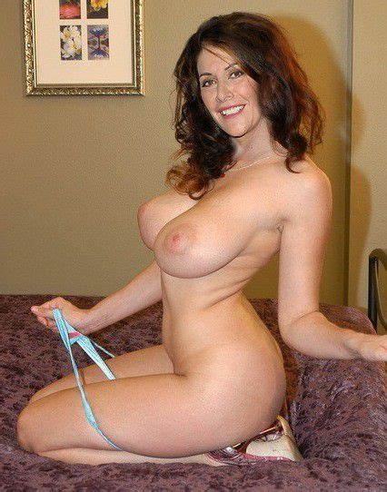 Busty MILF On The Bed Titsnass
