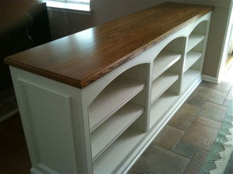 double sided built   wall bookcase mitre
