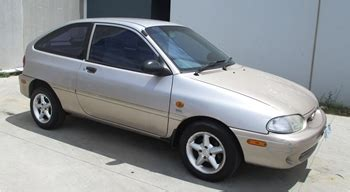 ford laser glxi   manual auction