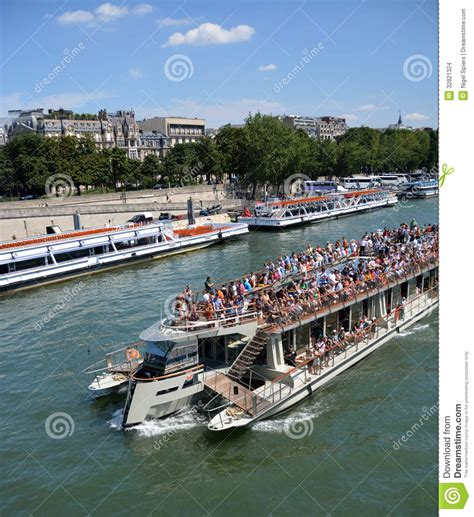 Boat Tour Seine River Paris by Tourists On A Seine River Boat Tour Of Paris France