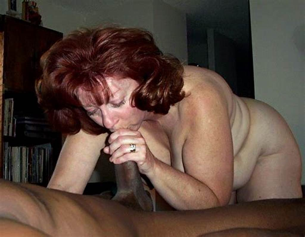 #Redhead #Mom #With #Short #Hair #And #Big #Beads #On #The #Neck
