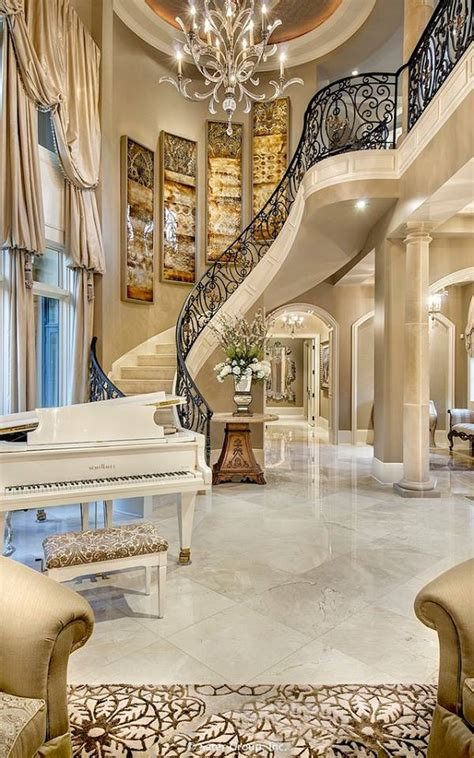 luxury foyer  straight staircase leads