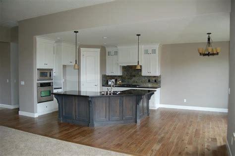 kitchen with grey island white cabinets zerra green slate backsplash black granite countertops