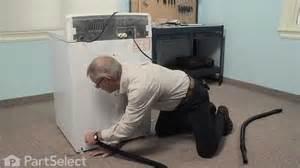 ge maker leaking water floor washer repair replacing the drain hose extension ge part