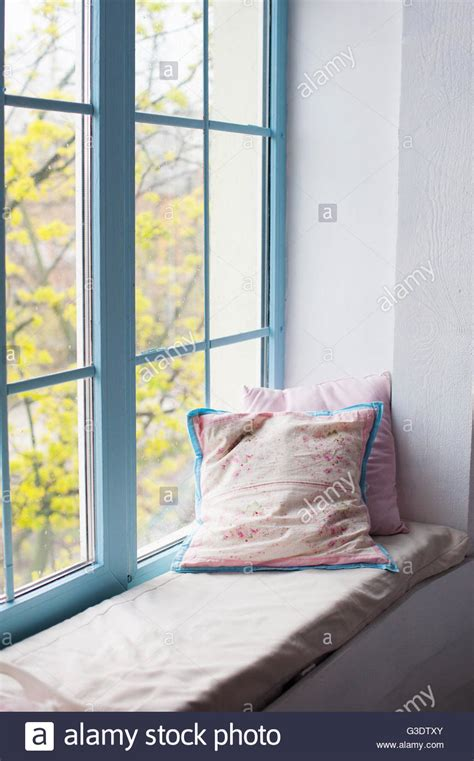 Window Sill Pillow by Two Pillows Airing On Window Sill In Room Stock Photo