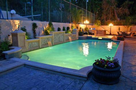 Grecian Pool And Spa With Raised Bond Beam, Travertine