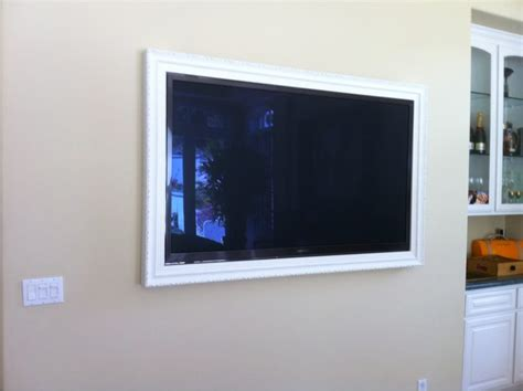 Wall Mounted Tv With Picture Frame Around It