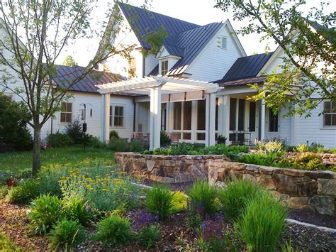 Charming Farmhouse by Charming Farmhouse With Wildflower Garden And Pergola Hgtv